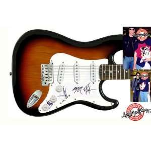 Queens of the Stone Age Autographed Signed Guitar & Proof